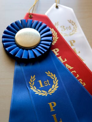 First, second and third competition ribbons.