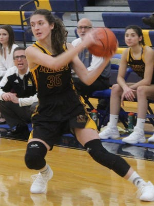 Mercy senior co-captain Bella Dugas (35) provides veteran leadership on a very young Marlins basketball squad.