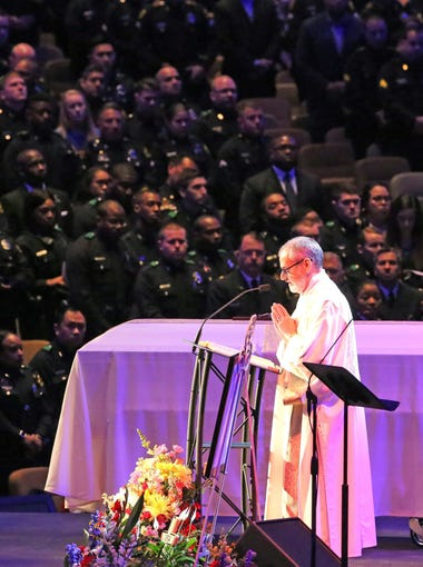 Scripture is read at the funeral for Dallas police Officer Rogelio Santander at Lake Pointe Church in Rockwall, Texas, on Tuesday. Santander was fatally shot April 24 at a Home depot in the Dallas area.