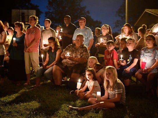 The community gathers at a vigil outside Burnette Chapel