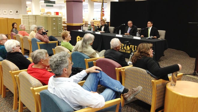 """Panelists Dr. Mary Hotvedt, from left, and Karen Whitlock, both Democratic candidates for House District 38, and Rudolpho """"Rudy"""" Martinez, Democratic candidate for the House District 39, joined Sen. Howie Morales for the Grant County Democratic Party's Third Thursday forum on Thursday at the Miller Library on the WNMU campus. The panel discussed the state's economic woes and the ramifications of the budget cuts resulting from the decline in oil and gas revenue."""