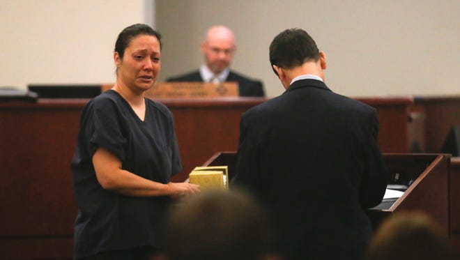 Tiki Marez addresses the family of Daniel Boone on Thursday during her sentencing at the 11th Judicial District Court in Aztec. Marez was convicted of second-degree murder in Boone's 2014 death.