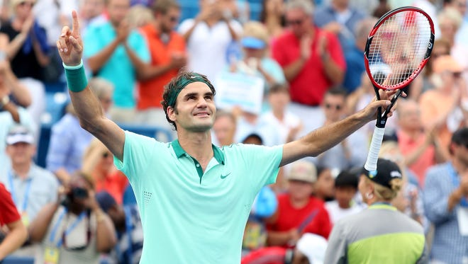 Roger Federer celebrates his sixth Western & Southern Open title with a 6-3, 1-6, 6-2 win over David Ferrer Sunday at the Lindner Family Tennis Center.