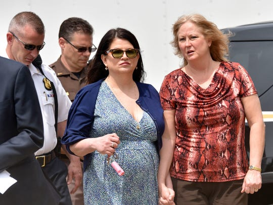 Annie Godbout, left, best friend of Kimberly King and Konnie Beyma, Kimberly's sister, walk to the press conference.
