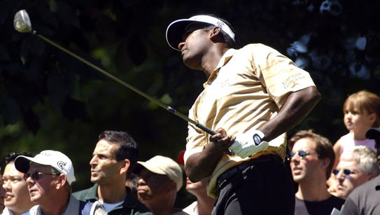 Vijay Singh watches his shot from the third tee during