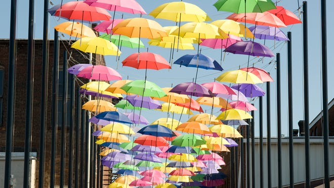 """Located next to Louisville's Ahh Art Gallery, """"Umbrella Alley"""" is pictured Tuesday June 30, 2020. Michael Skolosh, Special to The Alliance Review"""