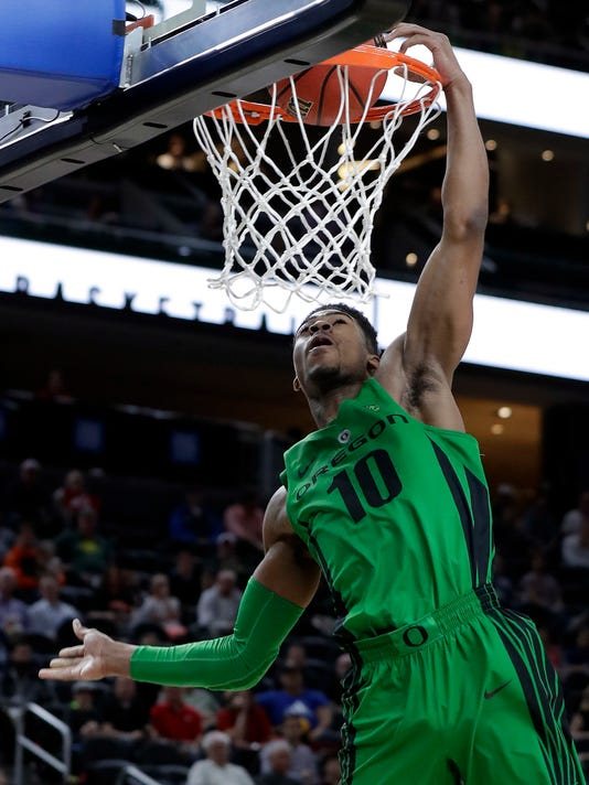 Oregon's Victor Bailey Jr. dunks during the first half of the team's NCAA college basketball game against Utah in the quarterfinals of the Pac-12 men's tournament Thursday, March 8, 2018, in Las Vegas. (AP Photo/Isaac Brekken)