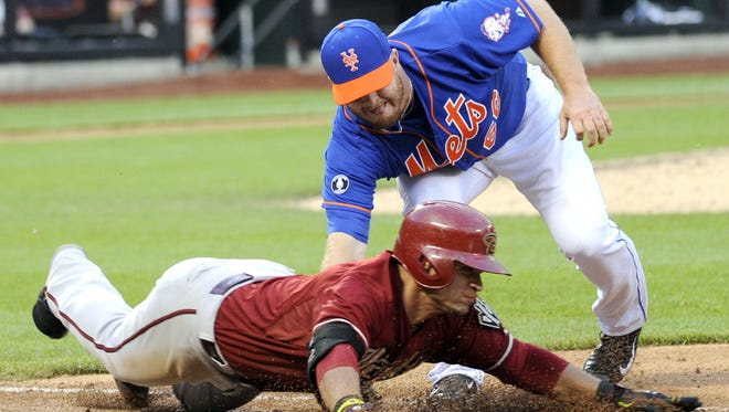 New York Mets pitcher Josh Edgin tags out Arizona's Gerardo Parra during a game in 2014. Edgin returned this summer after missing a season for Tommy John surgery.