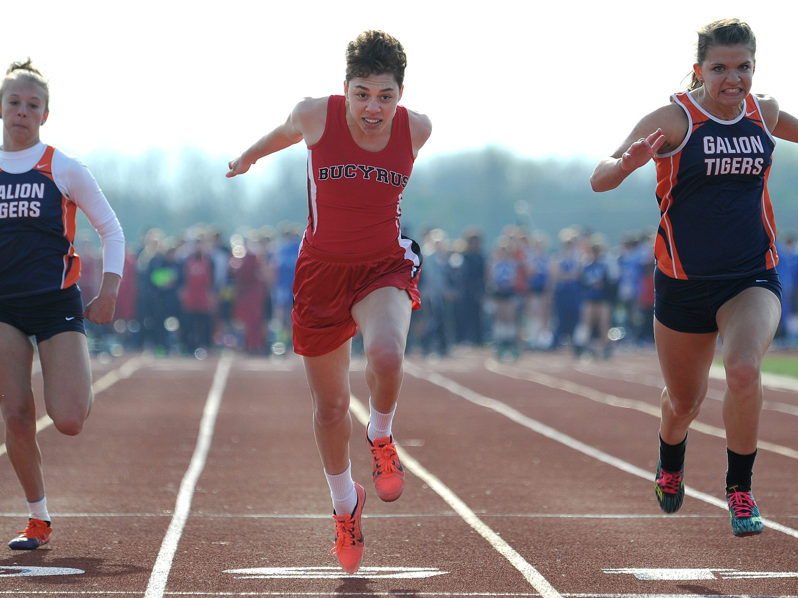 Bucyrus' Brittany Parsell stretches herself across the finish line of the 100 meter dash Friday evening at the Crawford County Track Meet.