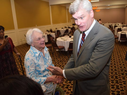 ANI Vitter Cassidy U.S. Sen. Bill Cassidy jokes around 96-year-old Sara Simmonds who recently went zip lining. Cassidy and U.S. Sen. David Vitter were in Alexandria to speak at a Central Louisiana Chamber of Commerce event.-Melinda Martinez/The Town Talk