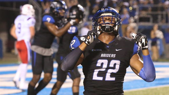 MTSU's Alex Dale (22) drops to his knees and celebrates