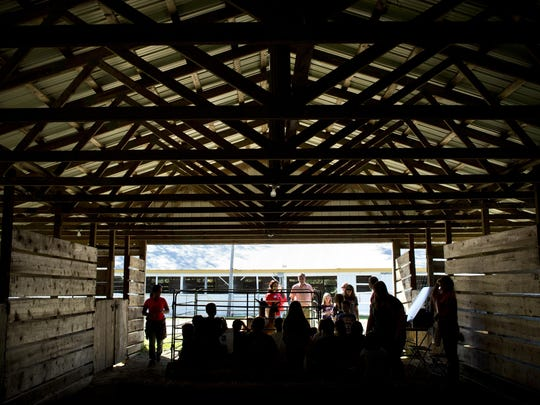 Students sit in a barn during Project Red Wednesday, September 23, 2015 at Goodells County Park. The event hosted nearly 600 area fourth-grade students to provide hands-on learning about farm life as part of Rural Education Day.