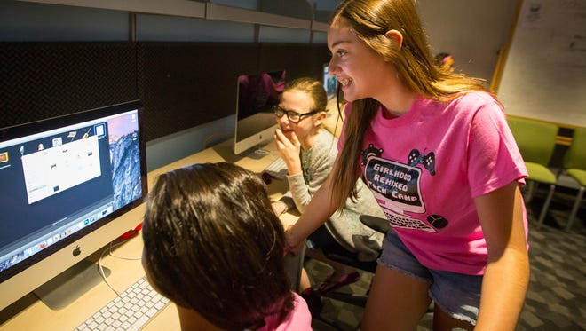 14-year-old Natalie Dominguez, right, works with other girls to make a podcast during the Girlhood Remixed Technology Camp at NMSU's Milton Hall, June 10, 2016. The camp aims to introduce girls to different types of technology and help them construct and challenge their online identities.