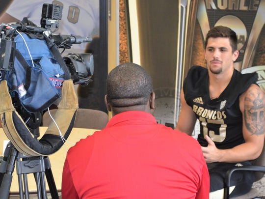 WMU tight end Giovanni Ricci talks to a reporter during Bronco Football Media Day on Sunday.