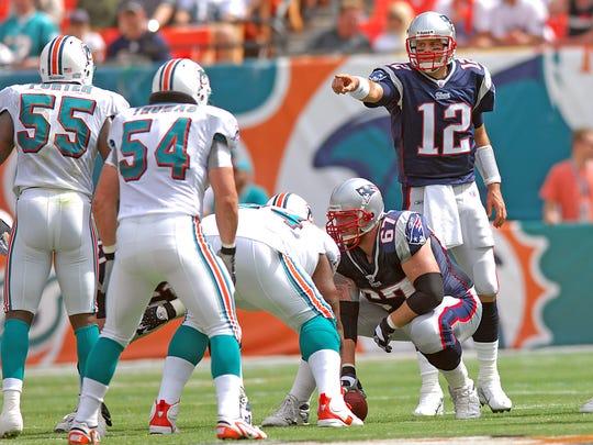 New England Patriots quarterback (12) Tom Brady points at Miami Dolphins linebacker (54) Zach Thomas and Miami Dolphins linebacker (55) Joey Porter during a game in 2007 at Dolphin Stadium.