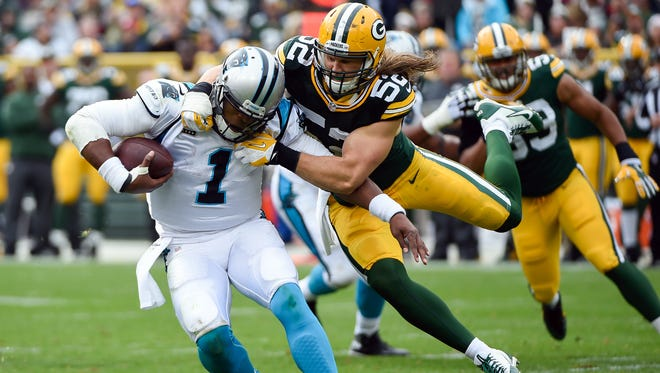 Oct 19, 2014; Green Bay, WI, USA; Carolina Panthers quarterback Cam Newton (1) gets away from Green Bay Packers linebacker Clay Matthews (52) to avoid a sack in the third quarter at Lambeau Field.