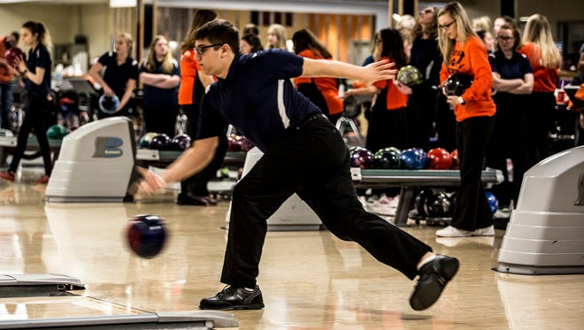 Granville sophomore Eric Stickley delivers the ball Saturday at Park Lanes againsr Heath.