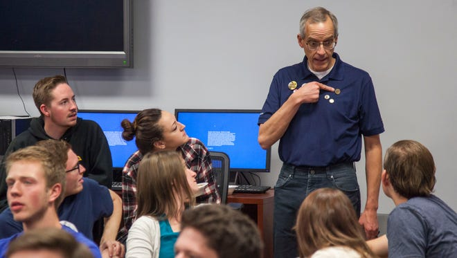 Southern Utah University President Scott Wyatt shows students a collection of historic buttons from past presidential candidates at an election watch party at SUU's Micheal O. Leavitt Center for Politics and Public Service, Tuesday, Nov. 8, 2016.