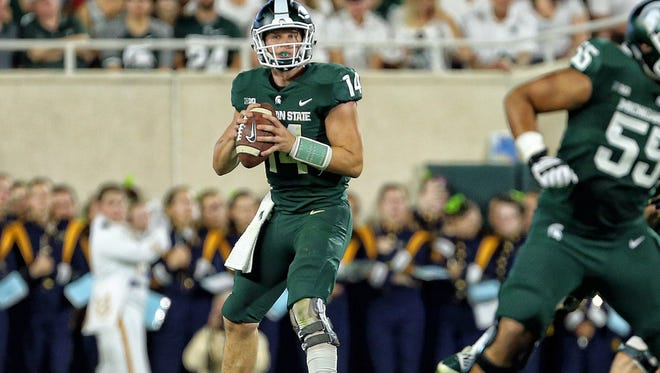 Michigan State Spartans quarterback Brian Lewerke (14) looks to throw the ball against Notre Dame Fighting Irish during the first half a game at Spartan Stadium.