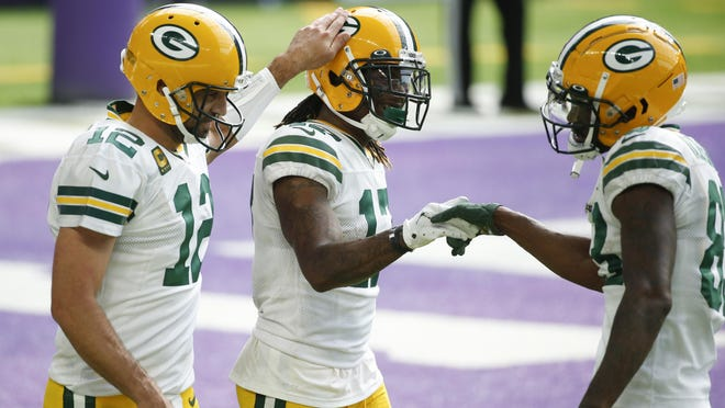 Green Bay Packers wide receiver Davante Adams, center, celebrates with teammates Aaron Rodgers, left, and Marquez Valdes-Scantling, right, after catching a 1-yard touchdown pass during the second half of an NFL football game against the Minnesota Vikings, Sunday, Sept. 13, 2020, in Minneapolis.