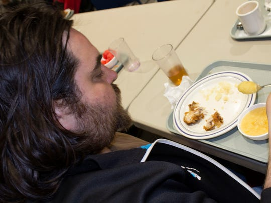 Jason Davies, 34, eats lunch at the Salvation Army in Chambersburg the afternoon of Monday, April 2. The nonprofit provides a safe space that offers lunch and breakfast to homeless residents and others in need.