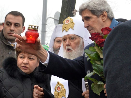 US Secretary of State John Kerry (R) and Ukraine's Patriarch Filaret speak as Kerry sets a candle to the Shrine of the Fallen, an homage to anti-government protesters, who died during the February clashes with anti-riot policemen, in Kiev on March 4, 2014. Kerry arrived in Kiev for talks with Ukraine's new interim government, amid an escalating crisis in Crimea. AFP PHOTO/ SERGEI SUPINSKYSERGEI SUPINSKY/AFP/Getty Images