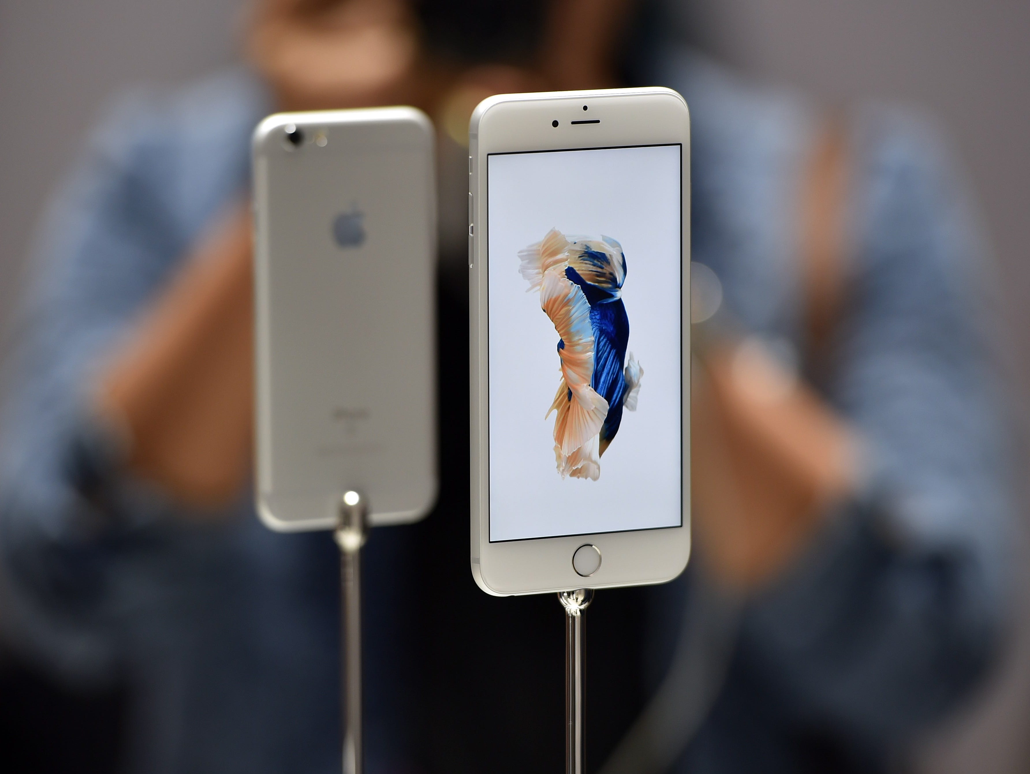 New models of the iPhone 6S are seen displayed during an Apple media event.