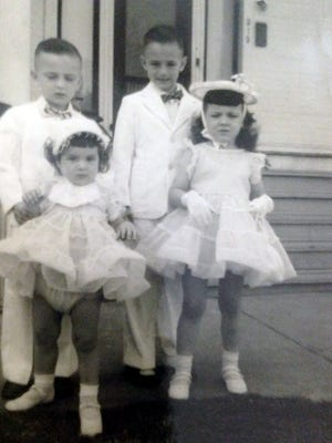 Jane Wallett in her Easter dress shown with her Wallett siblings as they get ready to leave their home on N. Court Street for the 1955 Easter Parade.