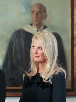 Governor Andrew Cuomo's girlfriend, Sandra Lee, listens as the Governor speaks after voting at the Presbyterian Church of Mount Kisco Nov. 4, 2014.