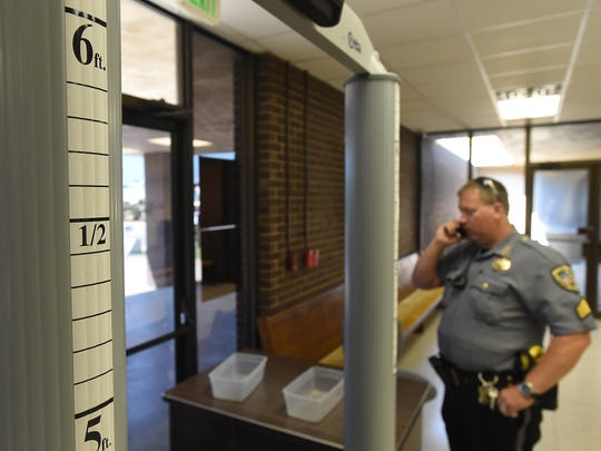 When people enter the Baxter County Court Complex, they pass through a metal detector.