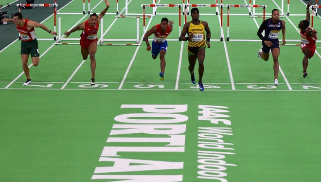 Jamaica's Omar McLeod races to the finish line during the 60 meter hurdles at the IAAF World Indoor athletic championships in Portland, Oregon on March 20, 2016.