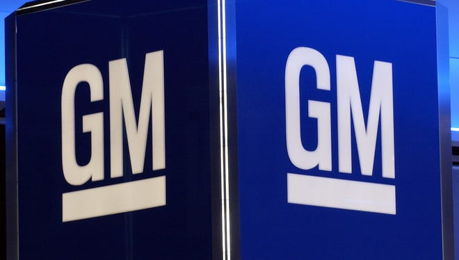 A record $12 billion pretax profit in North America will mean big checks for 52,000 union workers at General Motors. They'll get a record $12,000 each, up from $11,000 last year.