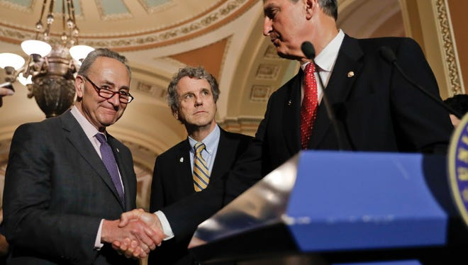 Senate Minority Leader Charles Schumer, D- NY., left, shakes hands with Sen. Joe Manchin, D-W.Va., right, accompanied by Sen. Sherrod Brown, D-Ohio, while speaking with reporters  about the budget on Capitol Hill in Washington May 2, 2017.