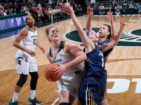 Michigan State's Jenna Allen, left, goes for a shot