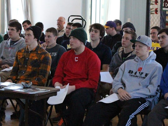 Prospective baseball umpires pay attention during Saturday's GCYBSA umpiring clinic at Cherry Hill School in Canton.