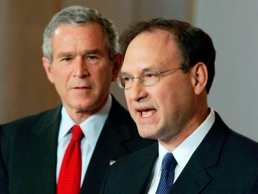 President George W. Bush listens to Samuel Alito speak