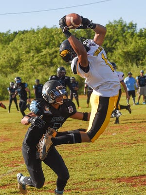 Eagles' player Kelvey Coney (1) attempts to make the catch against the Angels during their Budweiser Football League game at the Mikkel Tan I. Vy Field in Tiyan on Dec. 13.