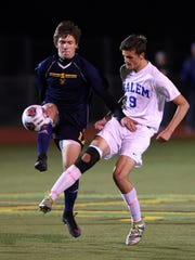 Vying for possession Tuesday night are Salem's Christian