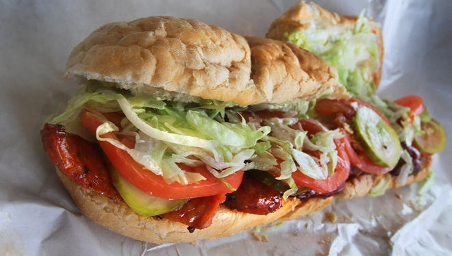 Served on the traditional sandwich paper, no frills just a good andouille sausage po' boy on real Louisiana bread, at B's Po Boys, 1261 Shelby St.