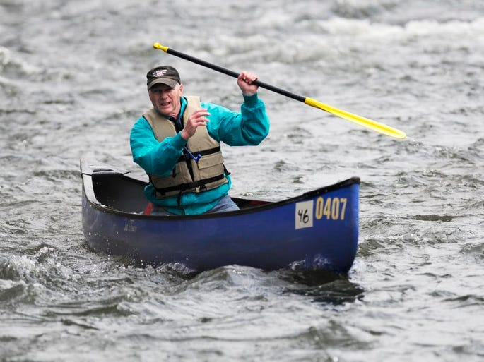 Rick Dennis of Poughkeepsie paddles through the Rochdale Rapids on the Wappinger Creek in the Town of Poughkeepsie on Saturday at the Wappinger Creek Water Derby. April 26, 2014