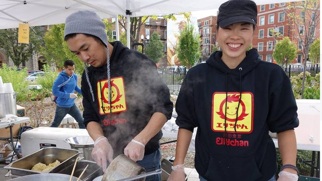 Hideki and Yuko Harada at the Asian Food Festival in Washington Park. They are owners of Kiki Japanese restaurant in College Hill