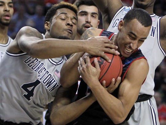 Georgetown guard D'Vauntes Smith-Rivera, left, fights for the ball with Eastern Washington guard Drew Brandon during the first half of an NCAA college basketball second-round game in Portland, Ore., Thursday, March 19, 2015.
