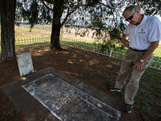 Larry Cornwell looks at the grave of Revolutionary War patriot Dixon Hall on Wednesday, Jun. 29, 2016 in Montgomery, Ala. Cornwell is the Genealogist General for the Sons of the American Revolution, and has located six graves of Revolutionary War patriots buried in Montgomery.
