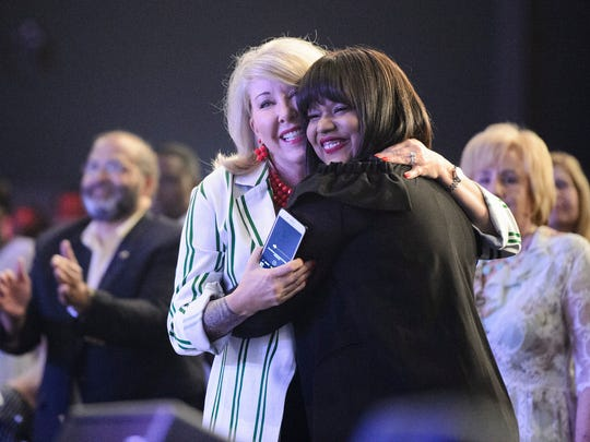 This 2018 file photo shows Aventer Gray and Hope Carpenter embracing in the farewell service held in honor of the Carpenters leaving Redemption Church, May 6, 2018 before their move to San Jose, Calif.