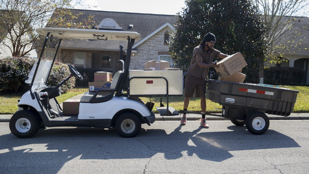 UPS uses neighborhood distribution points for home delivery via electric-powered golf carts.