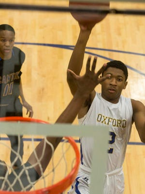 Oxford's Terry Williams aims for the basket as the Chargers defeated Canton 73-69 Saturday night.