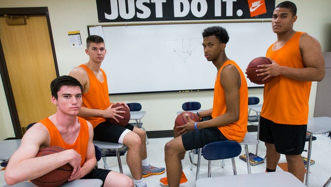 Top Corona del Sol basketball players (from left) guard Alex Barcello, forward Dane Kuiper, center Marvin Bagley III and forward Cassius Peat in a classroom in Tempe on Monday, Nov. 17, 2014.