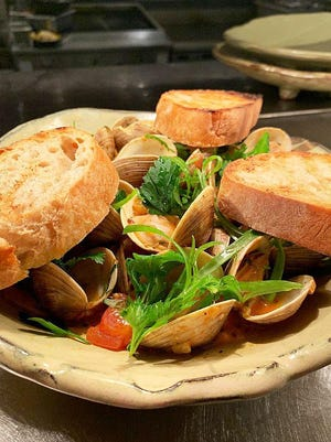 Clams di Franco is a flavorful dish at Cucina, served with toasted ciabatta for sopping up the dish's briny broth.