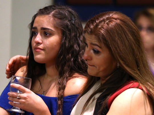 Scholarship recipient and Texas A&M University-Corpus Christi student Mariella Jimenez gets a hug from her mom, Maria Gutierrez, after speaking about her family's sacrifices on Wednesday, Sept. 20, 2017.