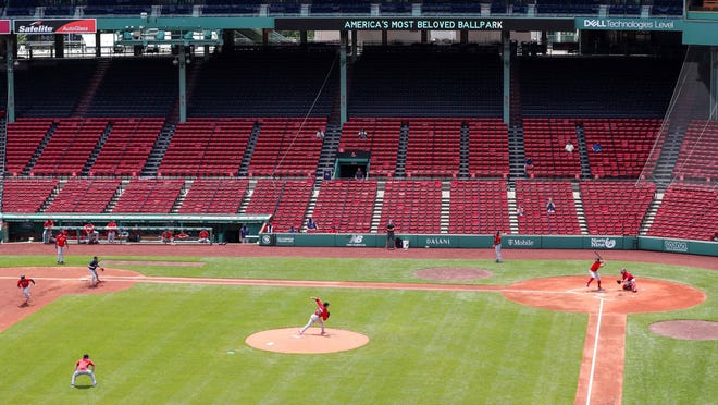 The Red Sox play an intrasquad  game at an empty Fenway Park on Friday. The team tested piped-in crowd noise and music to make the quiet ballpark seem more normal.